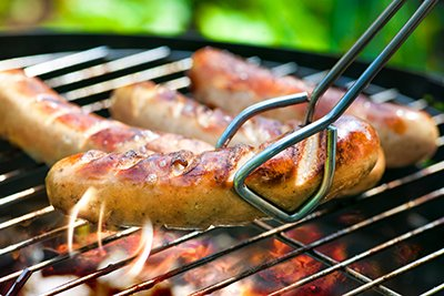 Sausages being grilled on barbecue