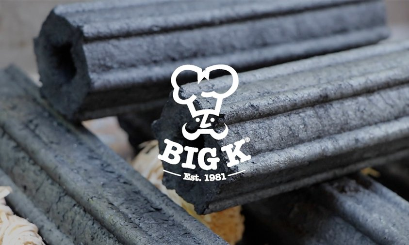 big k logo over au natural applewood charcoal in bbq