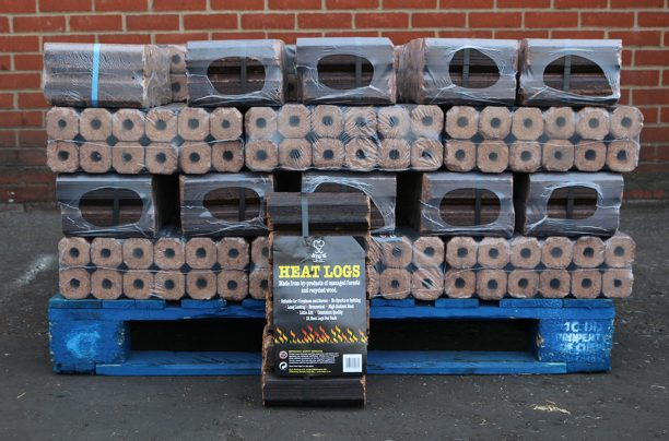 Half pallet of compressed saw dust heat logs