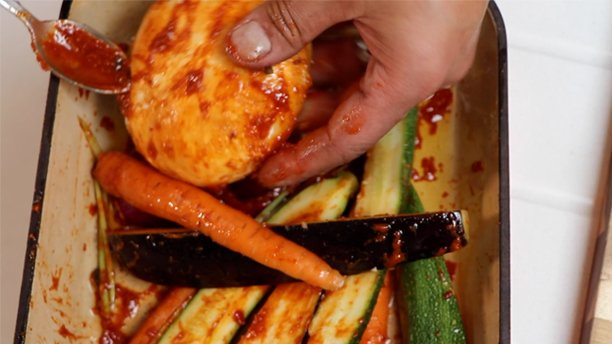 coating vegetables in harissa paste