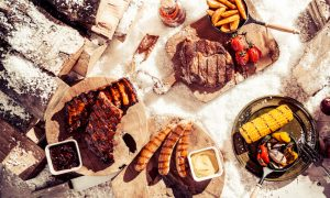 Barbecued foods on bed of snow for winter bbq