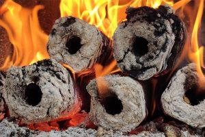 Compressed saw dust heat logs burning