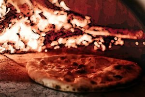 Alt text A crispy pizza set against a background of burning pizza oven fuel