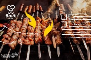 Skewered souvlakia grill and sizzle as part of a Greek BBQ feast