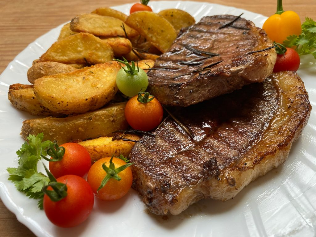 Move over other BBQ steaks, this ribeye steak on a plate accompanied by vegetables is definitely the king of steaks
