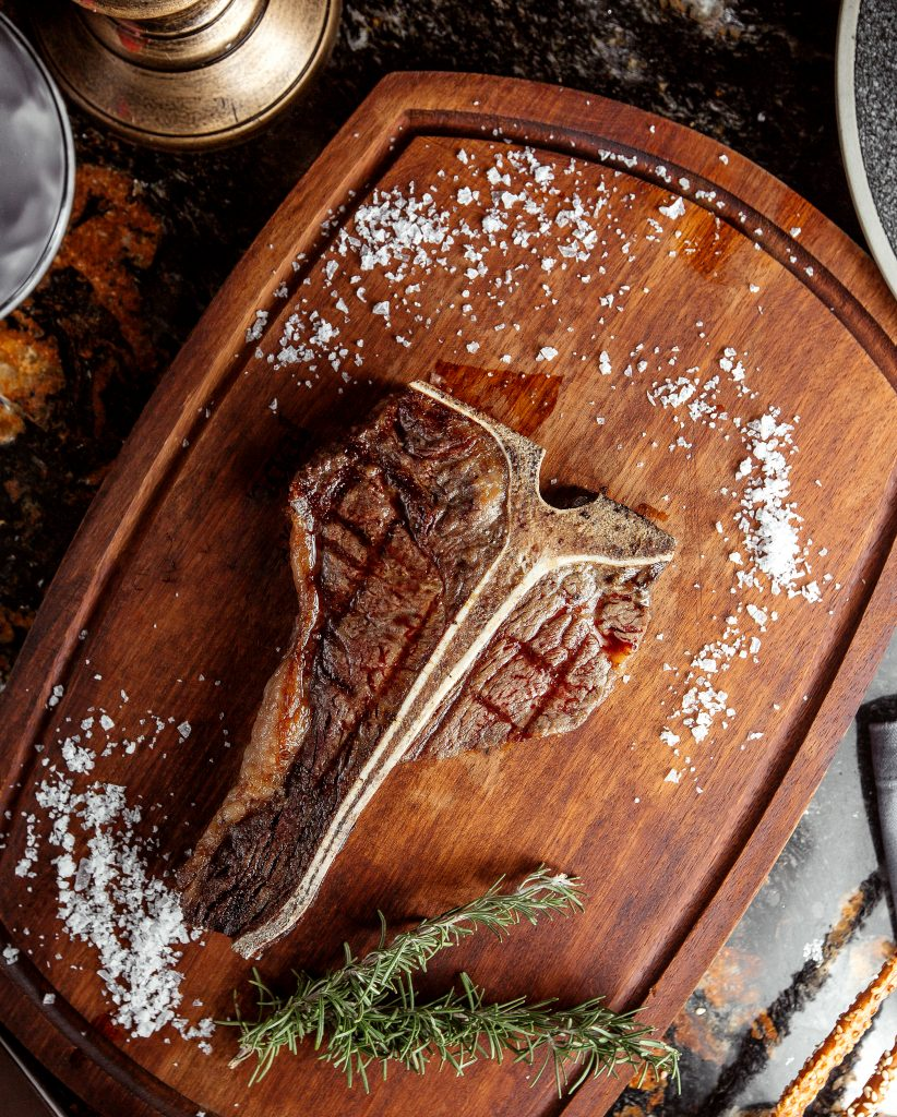 One of the most famous BBQ steaks, the T-Bone steak is on a plate ready to eat