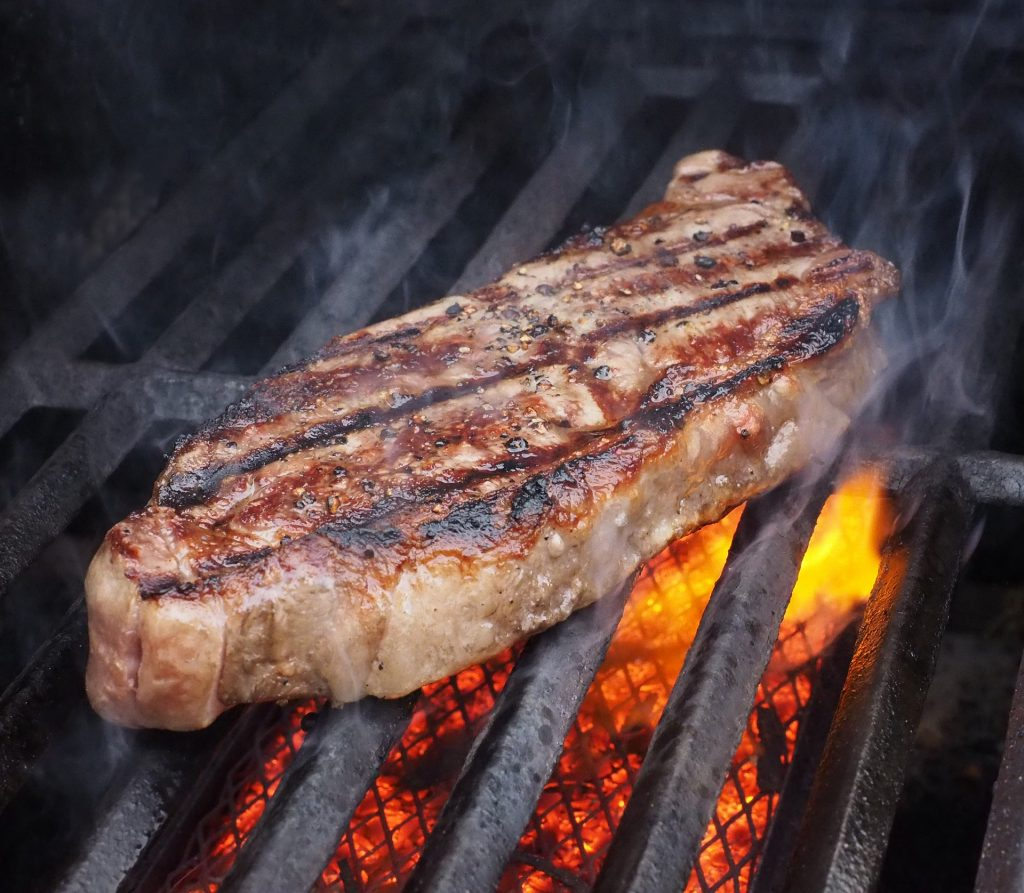 One of the leaner BBQ steaks, a strip steak is seared to perfection and ready to be eaten