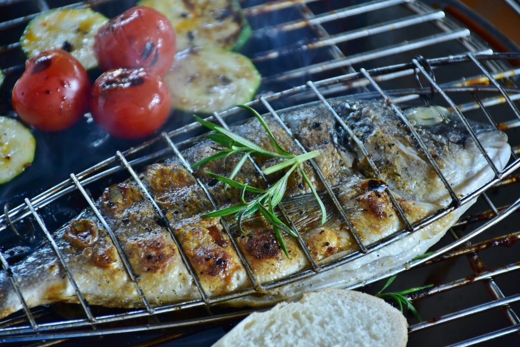 Perfectly cooked fish sits on the barbecue grill