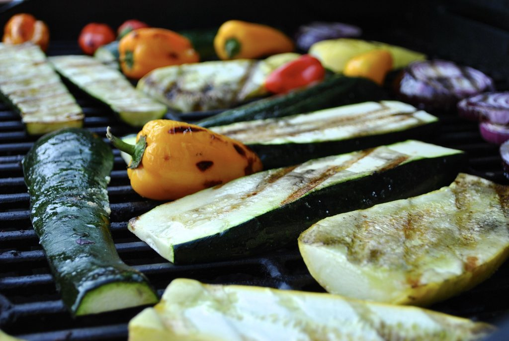 Lovely grilled fish sits on the barbecue grill