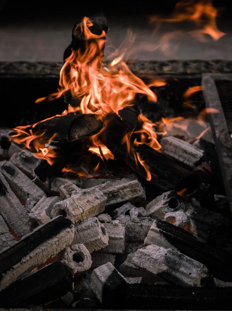 Some charcoal is lit and burning and charcoal can be a smokeless fuel
