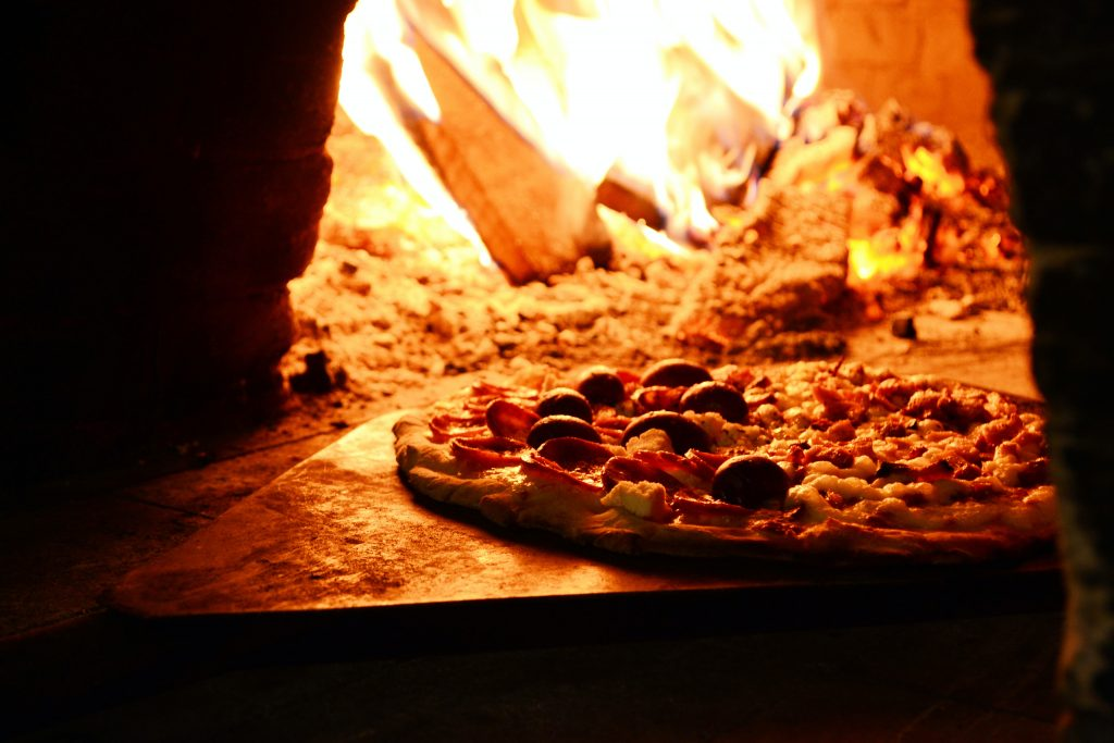 pizza oven fuel in a pizza oven burns brightly cooking a pizza