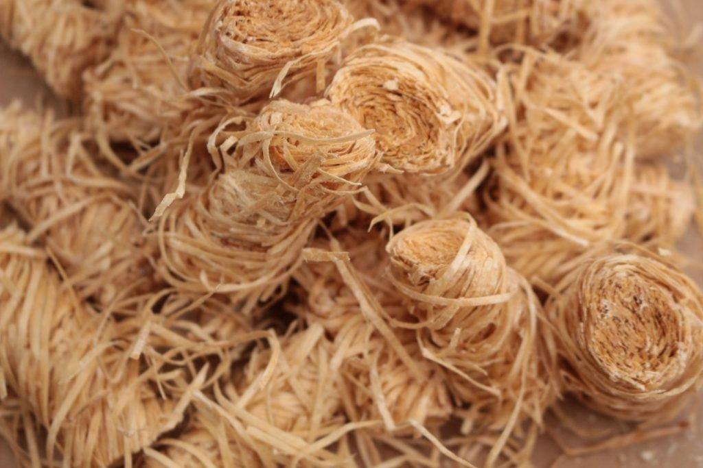 A close up shot of a wood wool firelighter cluster