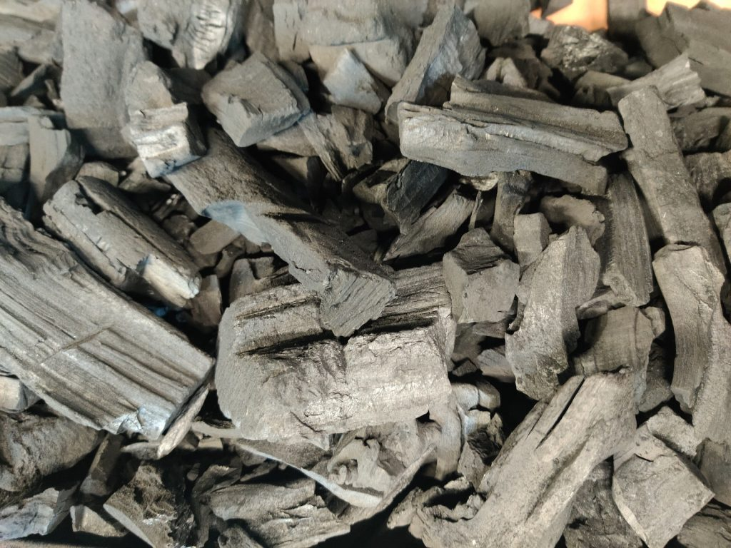 A fresh pile of lumpwood charcoal is ready to go
