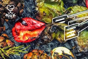 Many BBQ recipes are vegetarian such as these grilled green and red peppers softening up o a grill with charcoal at the base.