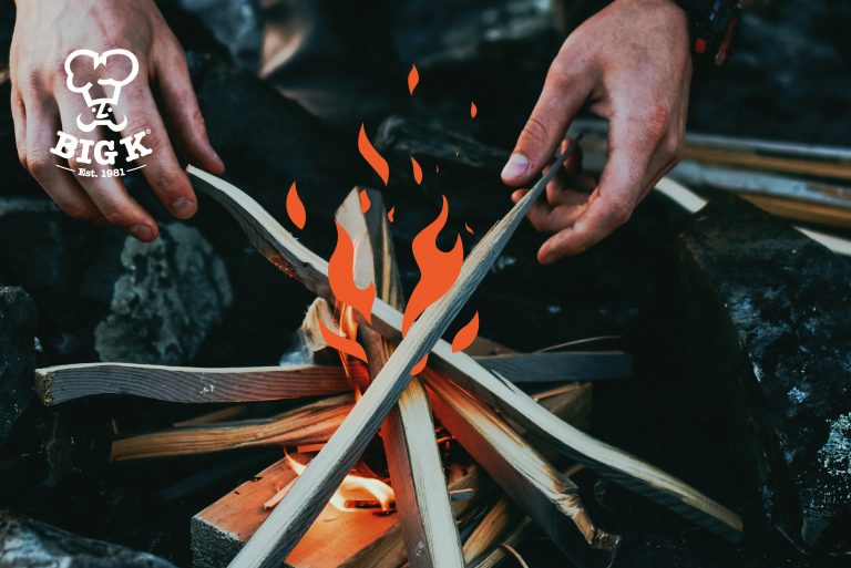 Alt text A man is starting a BBQ using a pile of kindling