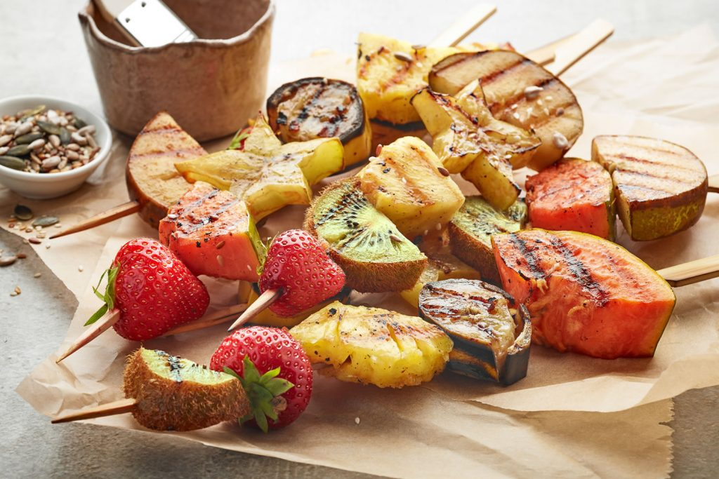 Some BBQ recipes such as these roasted fruit skewers with strawberry, kiwi and more, are fresh and healthy.