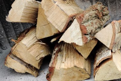 some kiln dried wood is chopped in a pile