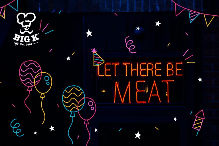 text A neon BBQ party sign shines stating let there be meat