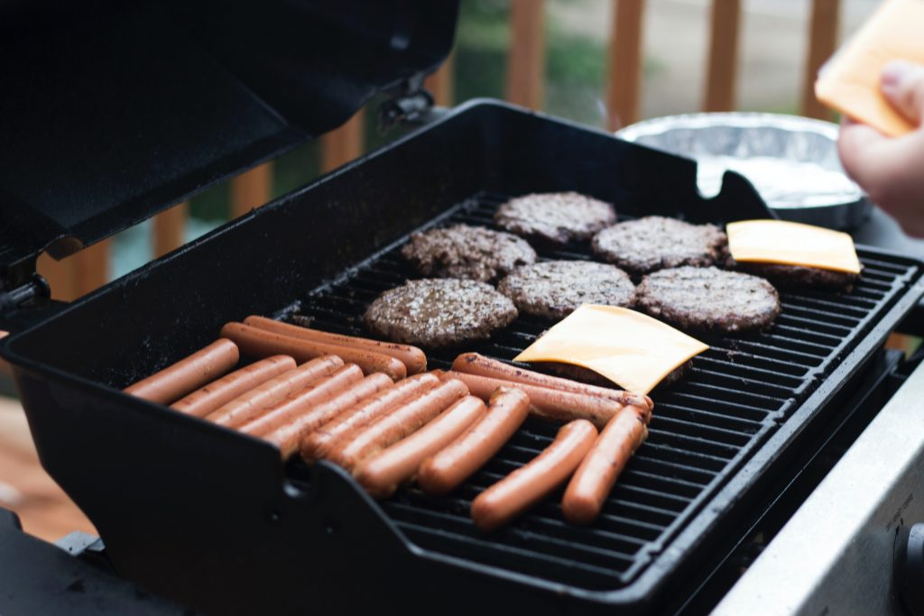 You can get a lot on a gas or charcoal BBQ, this gas BBQ is full of different sausages and burger patties