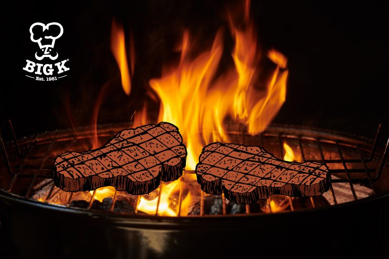 Two illustrated steaks lie cooking on a photo of a bbq grill containing burning charcoal with orange flames.