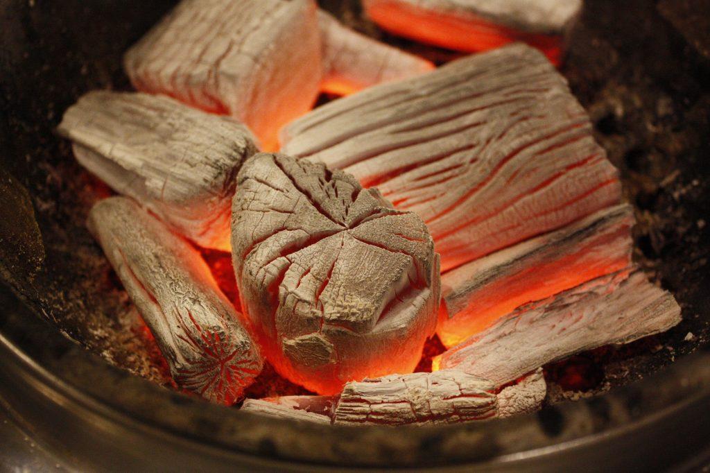 Smokeless fuel charcoal burns white hot with an orange glow