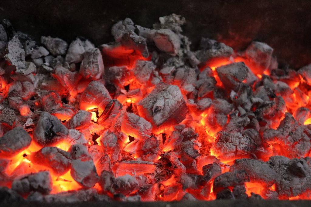 A pile of smokeless fuel smoulders to perfection with an orange and yellow glow