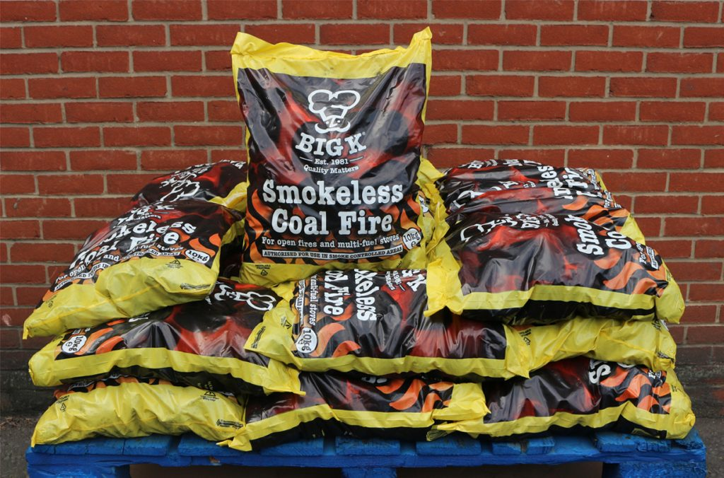 Smokeless coal is stacked on a pallet ready for sale as smokeless fuel