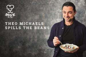 Celebrity Chef Theo Michaels poses for the camera holding a bowl of food