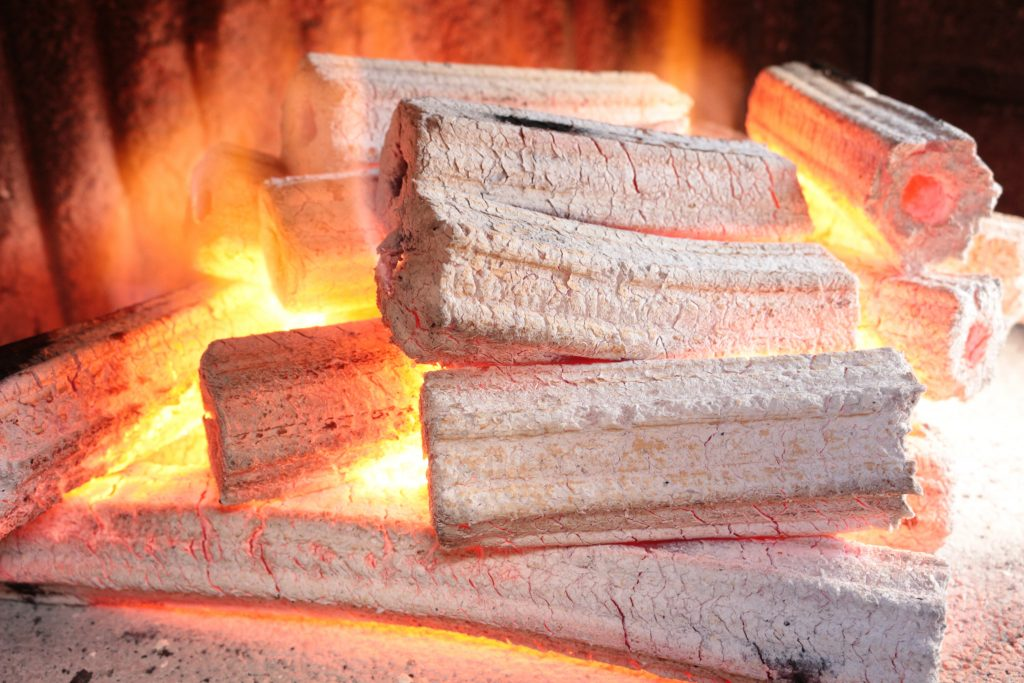A Smokeless fuel of Au Natural briquettes blazes red hot in a barbecue grill