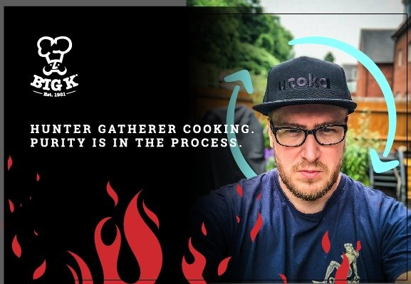 Alex AKA Hunter Gatherer Cooking stands looking into the camera with a serious facial expression wearing a cap.